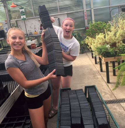 The flower pot girls Hailey Suwalski and Kensey Reeves are Chippewa Junior High School students looking to give back to the community.
